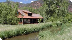 A cabin along the Roaring Fork River